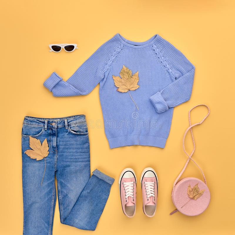 Autumn Fashion Clothes Outfit Flat lay. Maple Leaf. Fall fashion Flat lay. Trendy blue jumper, Stylish jeans, hipster sneakers, autumn Maple Leaf. Creative Woman stock photos