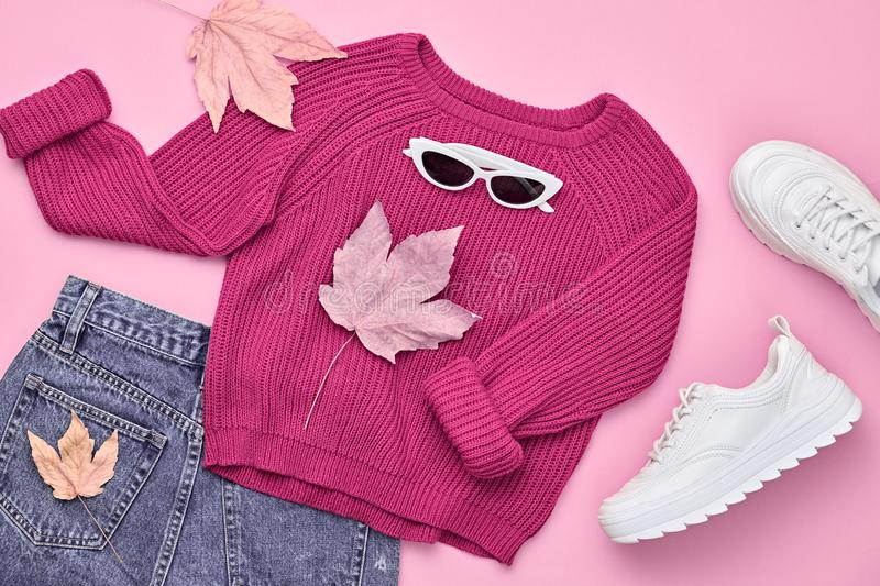 Autumn Fashion Clothes Outfit Flat lay. Maple Leaf. Fall fashion Flat lay. Trendy pink jumper, Stylish hipster sneakers, sunglasses, denim, autumn Maple Leaf stock photography