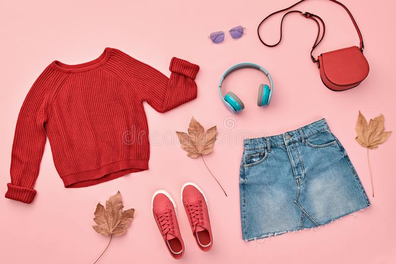 Autumn Fashion Clothes Outfit Flat lay. Maple Leaf. Fall fashion Flat lay. Trendy red jumper, Stylish hipster sneakers, headphones, denim, autumn Maple Leaf stock photography