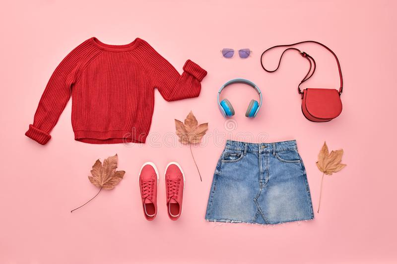 Autumn Fashion Clothes Outfit Flat lay. Maple Leaf. Fall fashion Flat lay. Trendy red jumper, Stylish hipster sneakers, headphones, denim, autumn Maple Leaf stock photos
