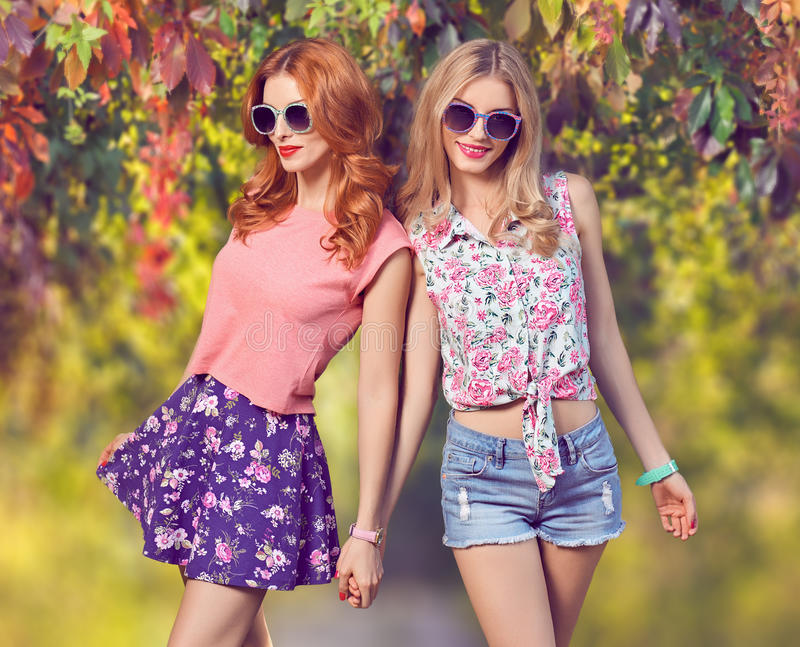 Fall Fashion. Friends Girl Having Fun.Outdoor Park royalty free stock image