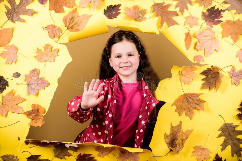 Fall fashion. Kid girl happy wear waterproof cloak. Enjoy fall weather with proper garments. Waterproof accessories make stock images