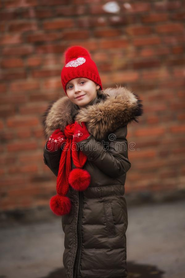 Fall fashion. Kid girl wear coat for fall season. Girl looking face cute hairstyle fashionable fall coat with hood and fur. royalty free stock photography