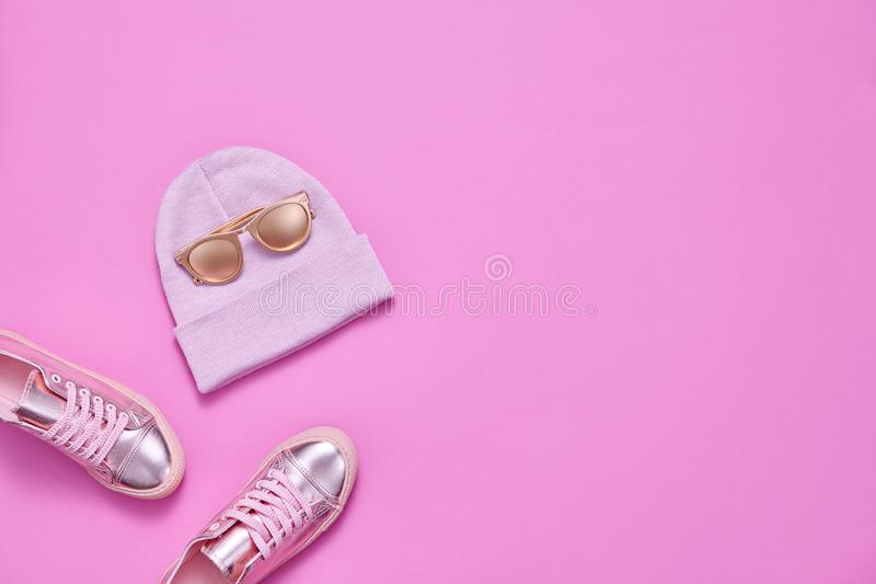 Fall Fashion Minimal Set. Autumn.Pink Pastel color. Autumn Fashion. Woman Gold Accessories Set. Minimal Creative Flat lay. Trendy Beanie Hat, Glamour Shoes stock image