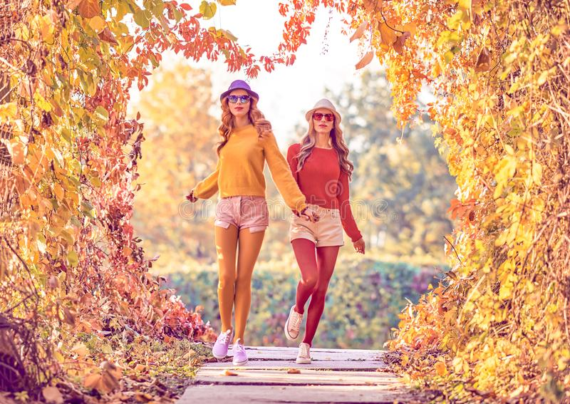 Fall Fashion. Urban Outdoor. Woman Walking in Park royalty free stock images