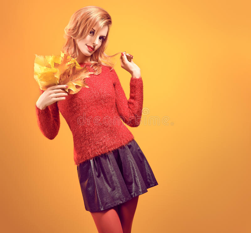 Fall Fashion. Woman in Autumn Outfit.Redhead Model. Fall Fashion. Model Woman in Autumn Fashion Outfit. Playful Beauty Redhead girl in Stylish fashion Sweater stock photography