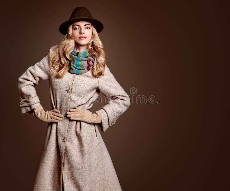 Fall Fashion. Woman in Autumn Outfit. Stylish Coat. Fall Fashion. Model Woman in Autumn Fashion Outfit, Stylish Coat Trendy Hat, in Scarf, Gloves. Fashion Makeup royalty free stock photography