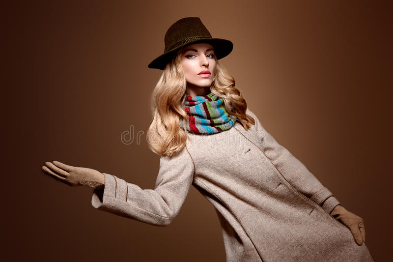 Fall Fashion. Woman in Autumn Outfit. Stylish Coat. Fall Fashion. Model Woman in Autumn Fashion Outfit, Stylish Coat Trendy Hat, in Scarf, Gloves. Fashion Makeup stock images