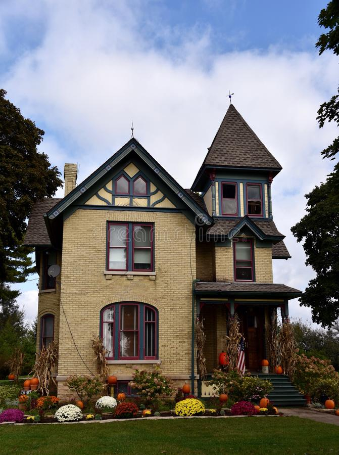 Fall Festival Italianate. This is a Fall picture of a House decorated for the Fall season located in Burlington, Wisconsin. This house built in 1855 is an stock photography