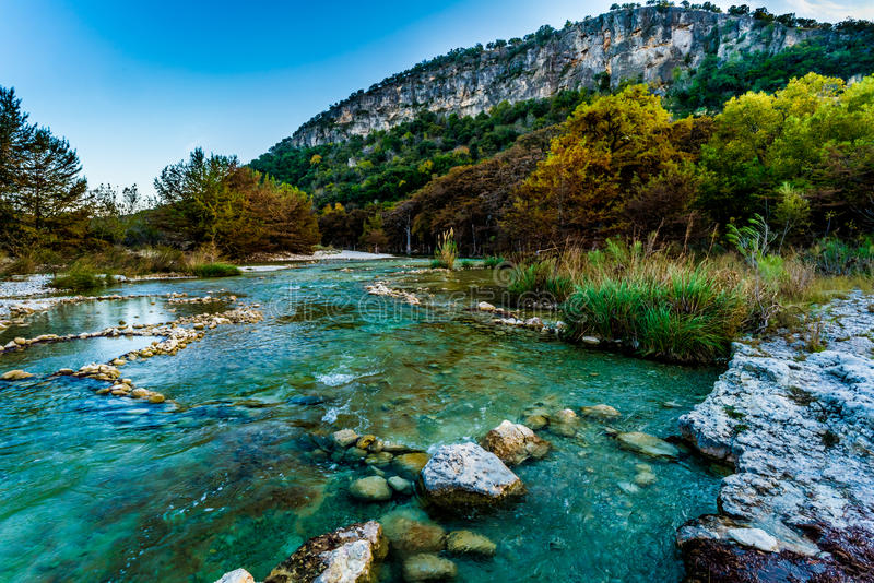 Fall foliage on the crystal clear Frio River in Texas. stock images
