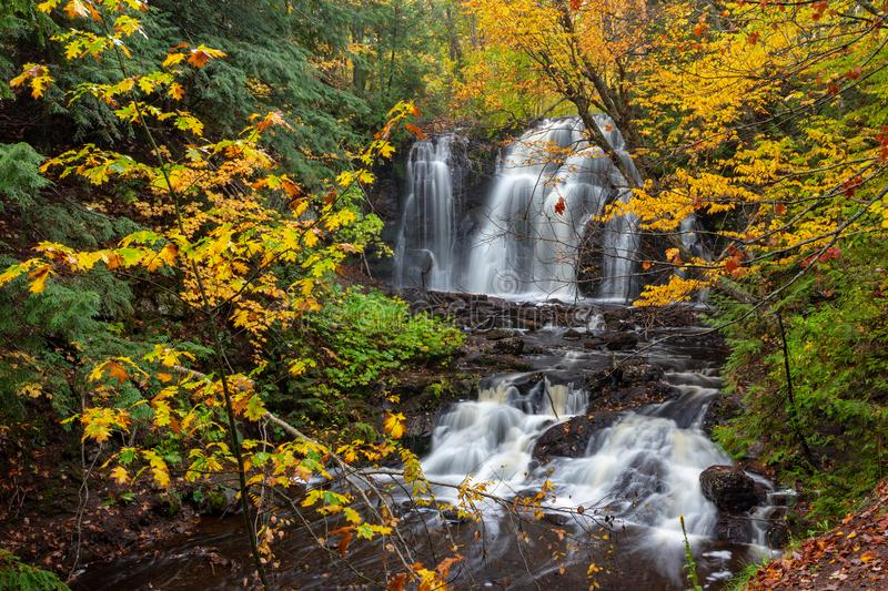 Upper Hungarian Falls in the Keweenaw Peninsula of Michigan, USA. Fall foliage and ferns frame Hungarian Falls in the Keweenaw Peninsula of Michigan. Dover Creek royalty free stock photos