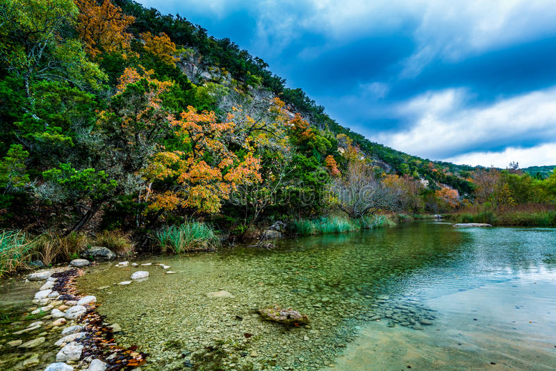 Fall Foliage at Lost Maples State Park in Texas. A Picturesque Scene of a Texas Hillside with Fall Foliage on a Crystal Clear Stream at Lost Maples State Park stock image