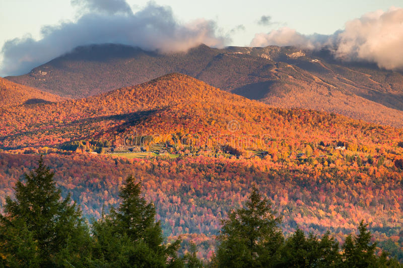 Fall foliage with Mt. Mansfield in the background. Fall foliage landscape with Mt. Mansfield in the background, Stowe, Vermont, USA stock photography