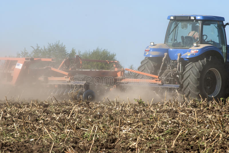Fall harrowing with tractor closeup