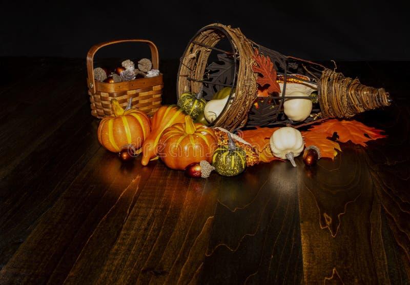 Fall Harvest Horn of Plenty. Fall harvest items are seen with decorative cornucopia on table top stock photos