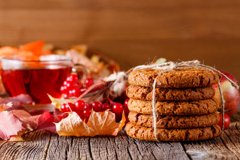 Fall harvesting on rustic wooden table with oat cookies. Fall wealth on rustic wooden background with oat cookies stock image