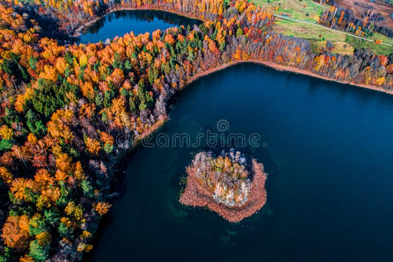 Fall lake, island in water stock images
