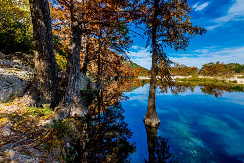 Fall Leaves, Blue Skies, and Clear Water at Garner State Park, Texas. Beautiful Fall Foliage Surrounding the Crystal Clear Frio River, Texas. Blue Skies stock photos
