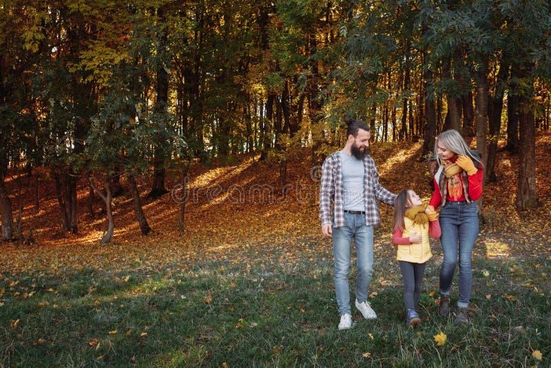 Fall leisure parents daughter walking nature park stock image