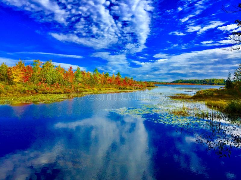 Fall on Little Indian pond in Maine royalty free stock photo