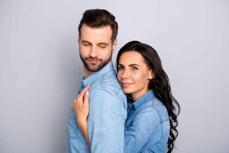 Fall in love. Close up photo of satisfied beautiful casual married students workers think dream future perfect family stock image