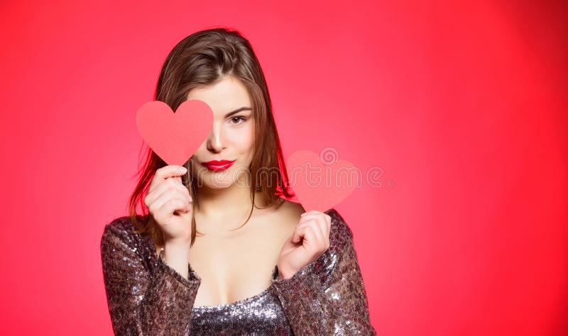 Fall in love. Girl adorable fashion model makeup face hold heart valentines card. Love from first sight. Woman in. Stylish dress hold symbol love. Romantic mood royalty free stock photo