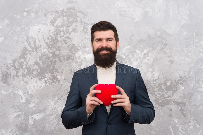 Fall in love. Love and romance concept. Bearded man hold plush toy red heart. Happy valentines day. Celebrate love. Gift. Shop. Gentleman get ready for date royalty free stock photography