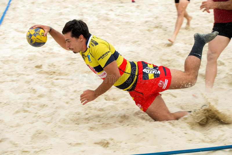 In the fall. MOSCOW, RUSSIA - JULY 22-23, 2017: Rugby players in action at the on European Beach Fives Rugby Championship 2017 in the match Spain yellow vs stock photography