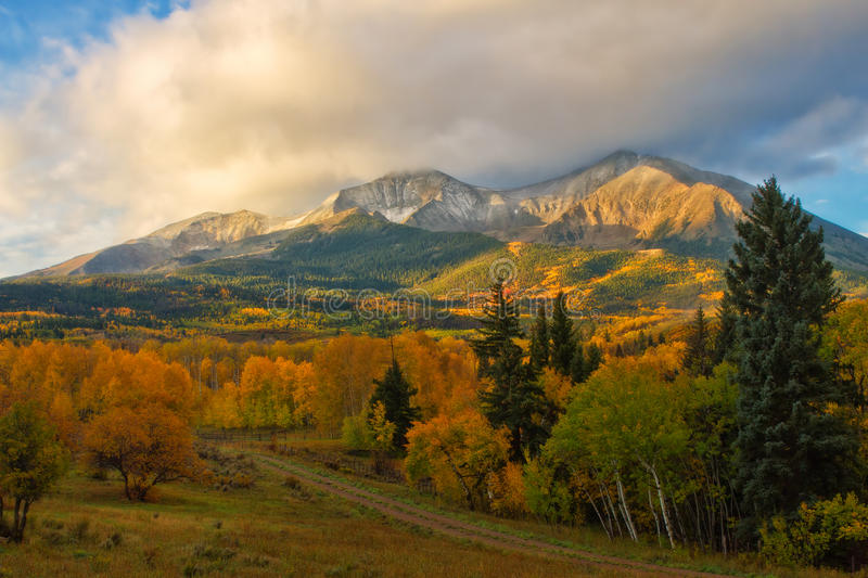 Fall on Mt Sopris. The clouds lifted on this autumn morning to reveal the beautiful peaks of Mt Sopris in Carbondale, Colorado stock photography