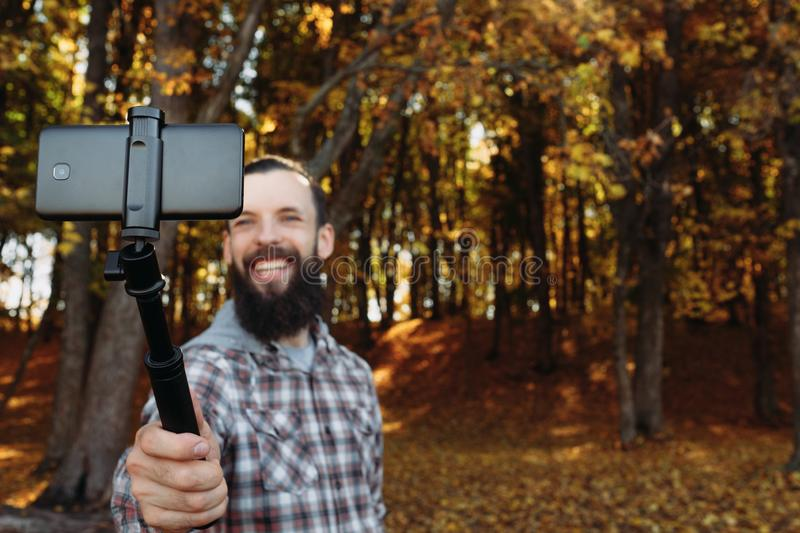 Fall nature leisure man selfie autumn forest stock photo