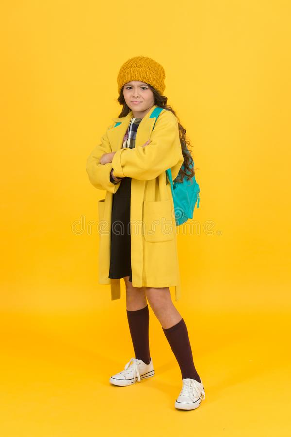 Fall outfit. Modern teen outfit concept. Outfit for daily school life. Feeling cool and stylish. Fall fashion. Little. Girl wearing stylish hat and coat stock photo