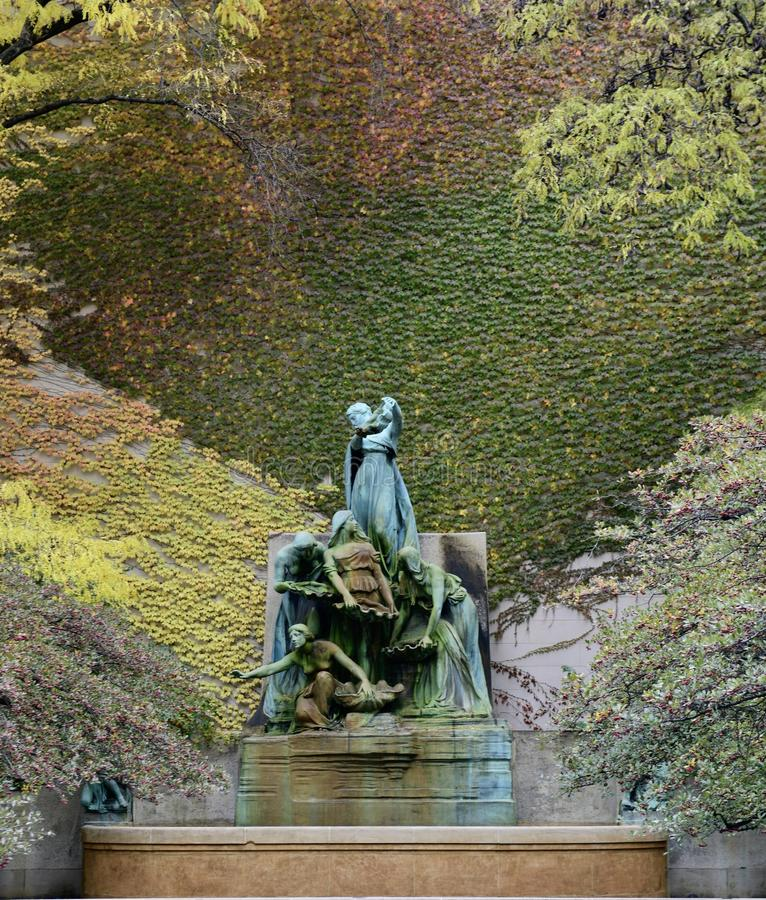A Fall Picture of the Fountain of the Great Lakes. This is a Fall picture of the iconic Fountain of the Great Lakes against a wall of ivy in fall foliage at the stock image
