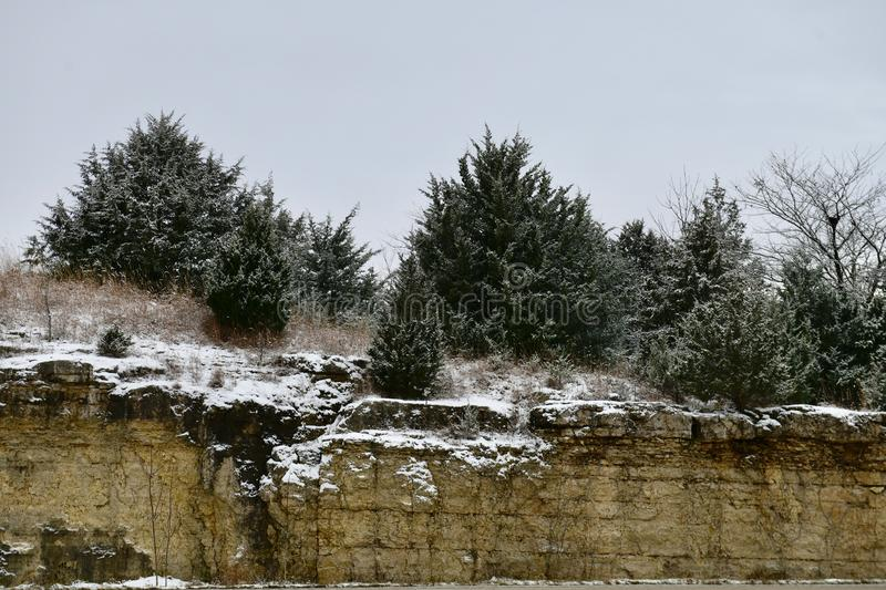 Snow on Limestone Ridge. This is an Fall picture of snow falling and accumulating on a Limestone ridge created with the building of I-72 located in Pike County stock photography