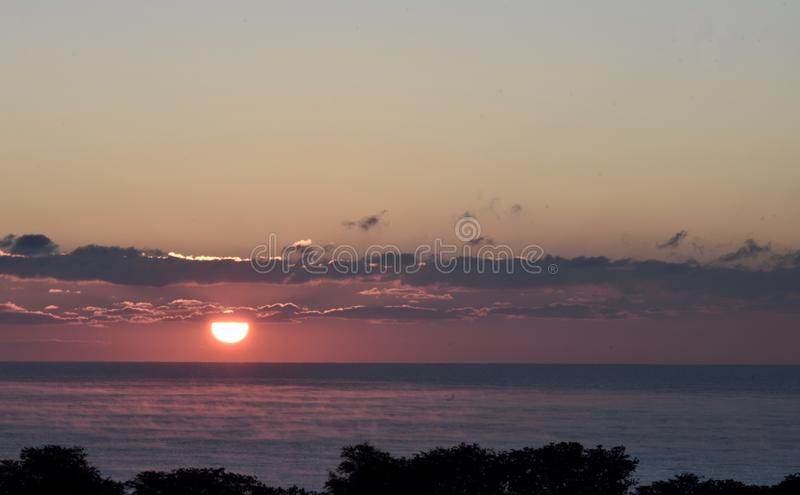 Tranquil Rising Sun. This is a Fall picture of a tranquil scene of the rising Sun with vapors rising off Lake Michigan located in Chicago, Illinois in Cook royalty free stock images