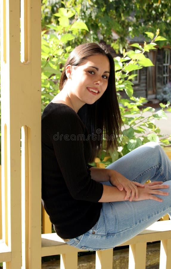 Fall Portrait. A beautiful teenage girl illuminated by the warm fall sunlight stock photo