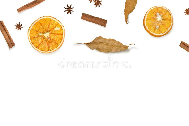 Autumn composition. Dried oranges, cinnamon, fall leaves and anise on white. Composition with spices and fruits. royalty free stock photos