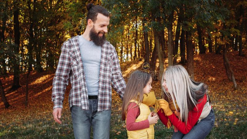 Fall season leisure happy young family nature park stock image