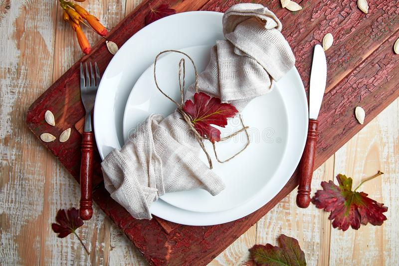 Fall table setting for Thanksgiving day celebration. On wooden background. Autumn table setting. Top view. Falt lay. Copy space stock photos