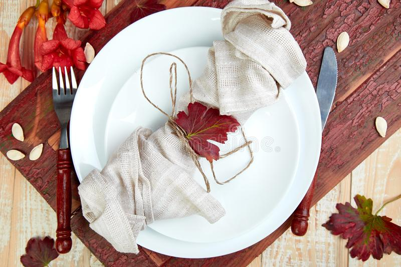 Fall table setting for Thanksgiving day celebration. On wooden background. Autumn table setting. Top view. Falt lay. Copy space royalty free stock photo