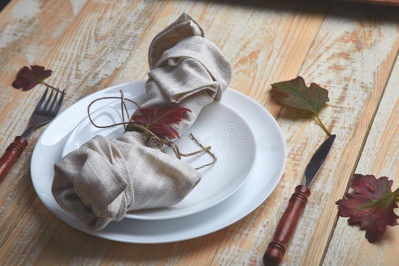 Fall table setting for Thanksgiving day celebration. On wooden background. Autumn table setting stock image