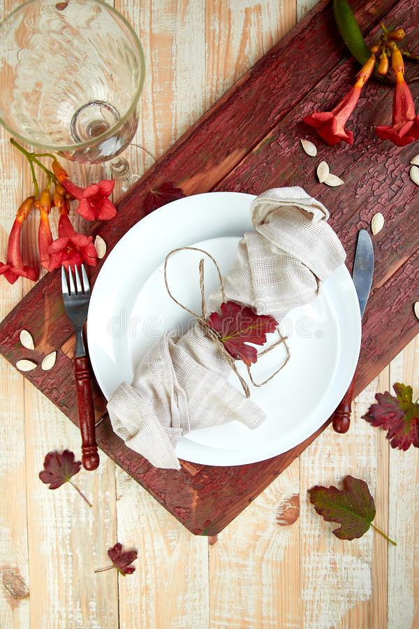 Fall table setting for Thanksgiving day celebration. On wooden background. Autumn table setting. Top view. Falt lay. Copy space royalty free stock photography