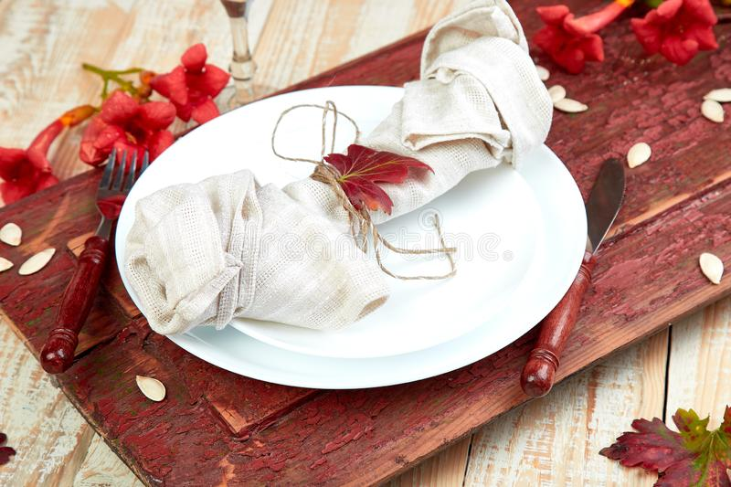 Fall table setting for Thanksgiving day celebration. On wooden background. Autumn table setting royalty free stock photos