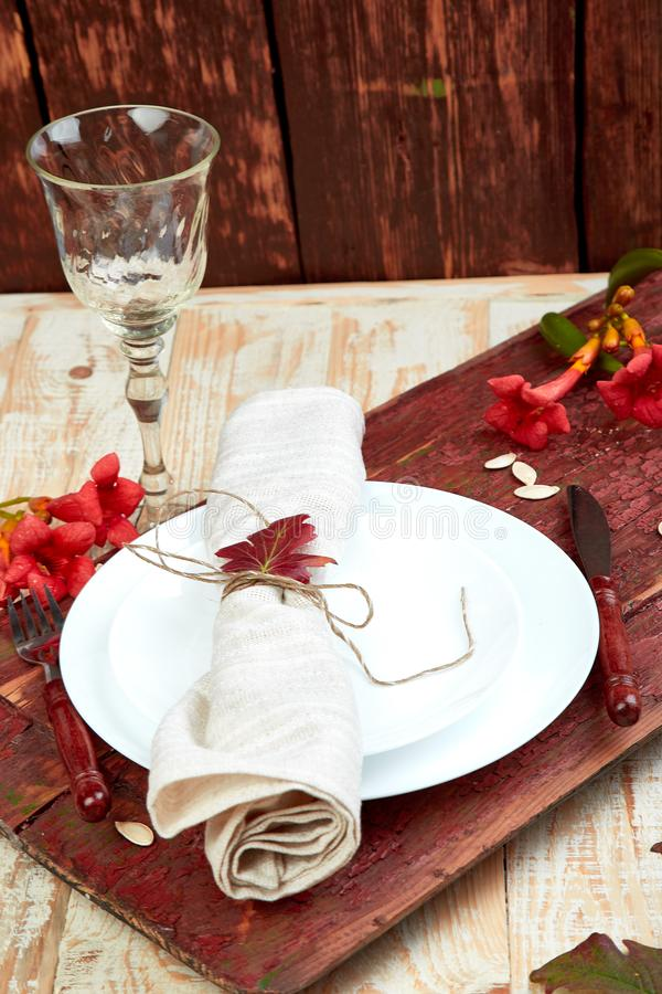 Fall table setting for Thanksgiving day celebration. On wooden background. Autumn table setting stock photos