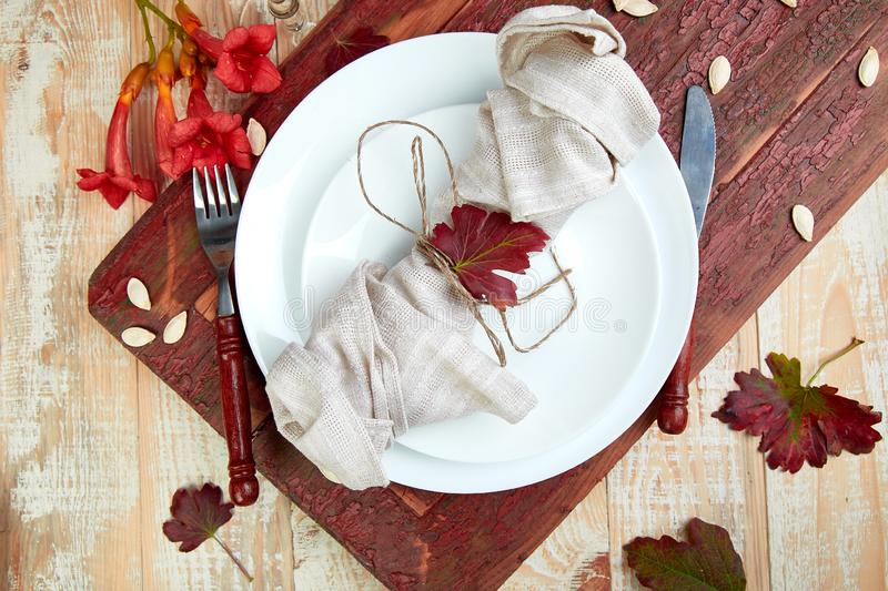 Fall table setting for Thanksgiving day celebration. On wooden background. Autumn table setting. Top view. Falt lay. Copy space royalty free stock images