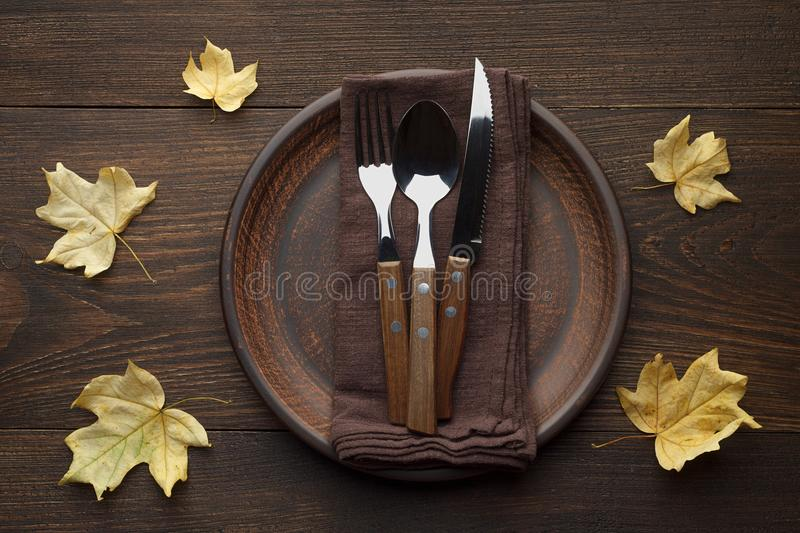 Download Fall Table Setting For Thanksgiving Dinner On Rustic Wooden Table With Yellow Maple Leaves. & Fall Table Setting For Thanksgiving Dinner On Rustic Wooden Table ...