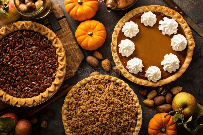 Fall traditional pies pumpkin, pecan and apple crumble. Pie overhead shot royalty free stock image