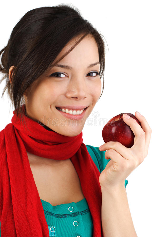 Fall woman eating red apple. Beautiful autumn woman eating a red apple. Isolated on white background royalty free stock image