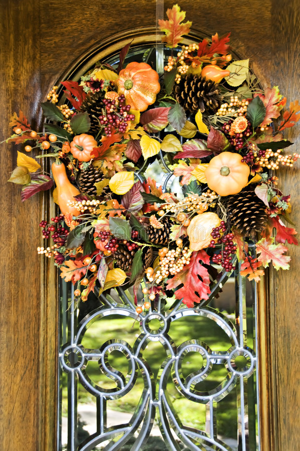 Fall Wreath. Beautiful fall wreath adorning a beveled glass door royalty free stock images