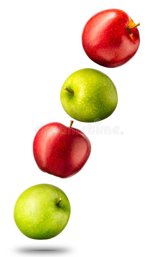 Falla röda och gröna äpplen på vit bakgrund royaltyfri foto