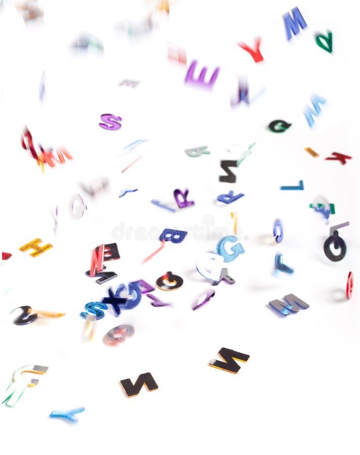 fallande bokstäver fotografering för bildbyråer
